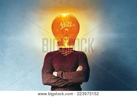 Concept of a new idea. A man with an incandescent lamp instead of a head.