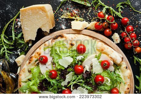 Chef's pizza with meat and vegetables. Special restaurant meal concept