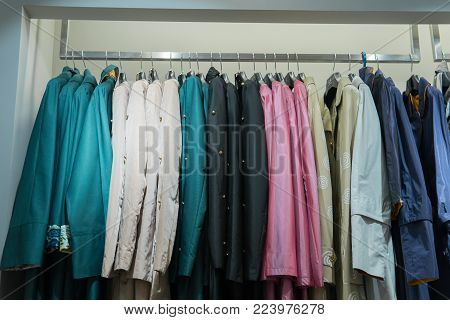 Row Of Autumn Coats Hanging On Rack, Shopping