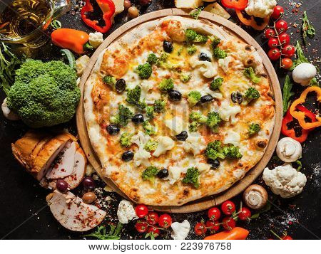 Vegan cauliflower broccoli pizza. Diet dish with lots of vegetable proteins for healthy nutrition concept