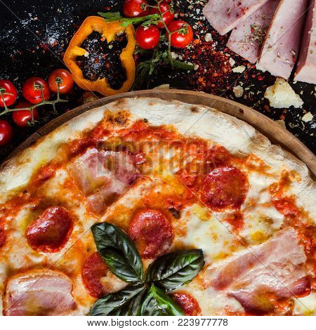 Pepperoni pizza. Fattening and delicious meal with lots of meat