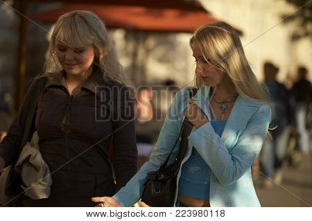 MOSCOW, RUSSIA: TWO ATTRACTIVE YOUNG WOMEN WALKING IN FRONT OF GUM DEPARTMENT STORE RED SQUARE, 30TH SEPTEMBER 2005, MOSCOW RUSSIA
