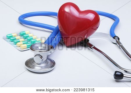 RX prescription, stethoscope, Red heart and pils on white backgroun