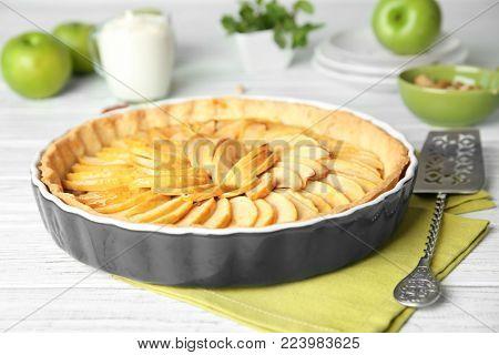 Homemade apple tart on wooden table
