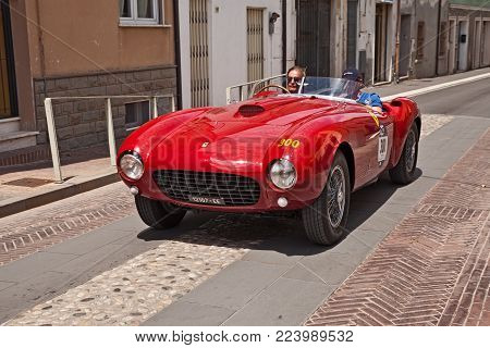 GATTEO, FC, ITALY - MAY 19: driver and co-driver on a racing car Ferrari 375 MM Spider Pinin Farina (1953) in historical classic car race Mille Miglia, on May 19, 2017 in Gatteo, FC, Italy