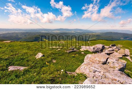 range of flat rocks on a grassy slope. beautiful summer scenery on high altitude in mountains
