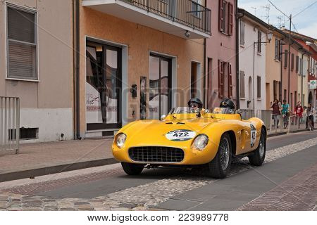 GATTEO, FC, ITALY - MAY 19: driver and co-driver on a racing car Ferrari 500 TR Spider Scaglietti (1956) in historical classic car race Mille Miglia, on May 19, 2017 in Gatteo, FC, Italy