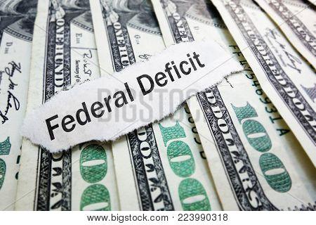 Federal Deficit newspaper scrap on hundred dollar bills
