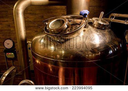 Brewery kettle closeup. Indoor brewery in basement, closeup.