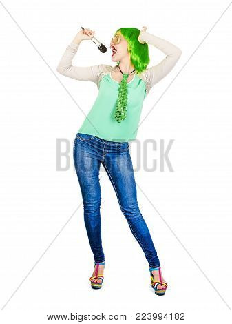 A gorgeous woman with a green wig enjoying singing, holding a microphone on a white background. The girl definitely knows how to perform. Colleagues were surprised by her voice. One day she will becom
