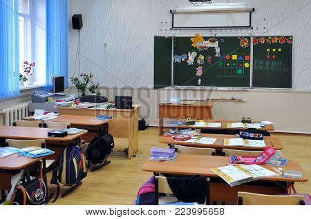 Gadjievo, Russia - September 24, 2012: The children left the classroom leaving things on the desks