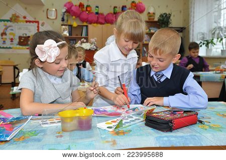 Gadjievo, Russia - September 5, 2012: Children draw at a lesson in primary school
