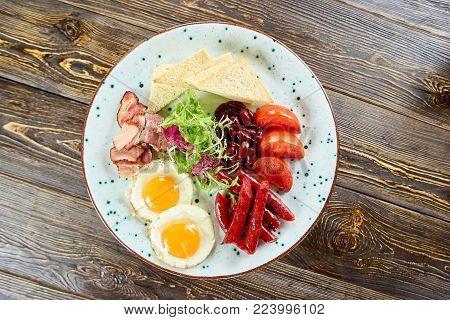 Fried juicy breakfast on plate. Various food in white plate. Beautiful looking food on plate.