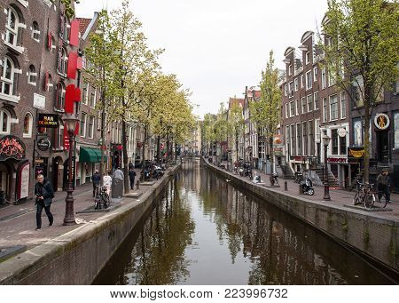 Amsterdam, Netherlands - April 20, 2017: Canal houses in the red light district, Amsterdam, Netherlands, Europe