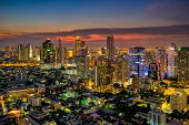 Sunset scence of Bangkok skyline Panorama and Skyscraper ,Aerial view of Bangkok modern office buildings and condominium in Bangkok city downtown with sunset sky and clouds at Bangkok , Thailand. poster