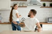 Angry husband and shocked insulted wife arguing in the kitchen, hungry mad boyfriend scolding offended girlfriend for bad cooking, unhappy couple having conflict quarrel disagree about food at home poster