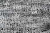 Abstract textured background of light gray putty on fabric basis. Rough texture as wall pattern poster