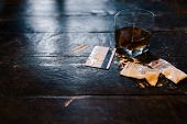 Cocaine and alcohol drink on dark background. Detrimental lifestyle. Bad habits. Alcohol and drug addiction. Important problem of modern society poster