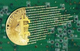 Bitcoins concept with electrical circuit in the back
