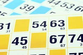 Bingo cards close up for lotto or bingo backgrounds with figures