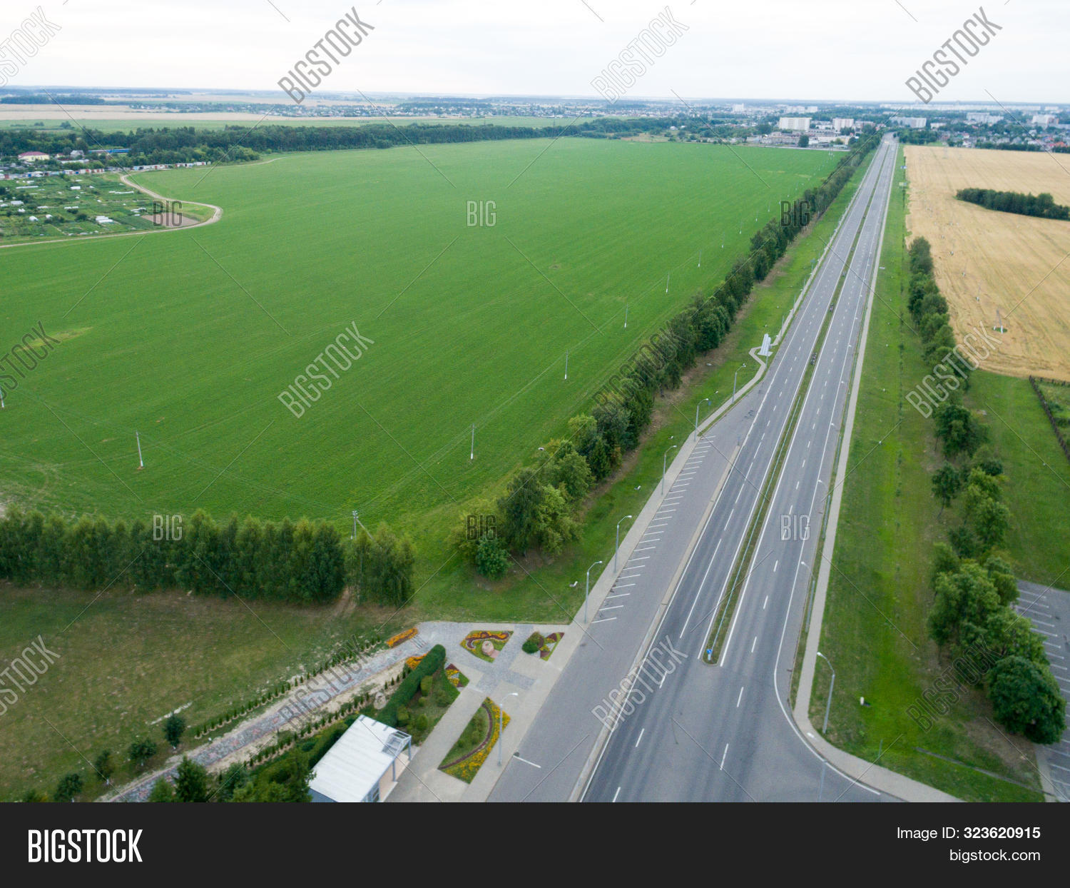 Top View Asphalt Road, Highway, A Crossroads In The Village On A Bright Sunny Day. Aerial Photo With