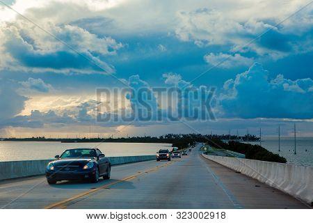 Florida Keys, Fl, United States - October 6, 2016: People Drive Through Overseas Highway Between Flo