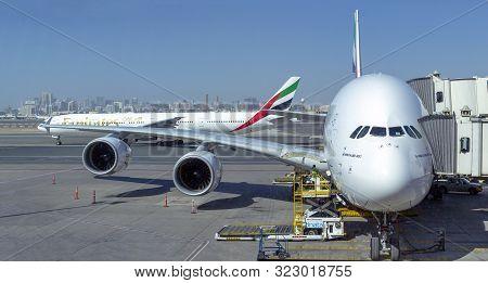 Dubai - April 7 2019: Emirates Airplanes Airbus 380 And Boeng 777 In The Dubai Airport, Uae, April 7