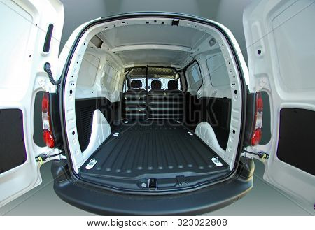 Empty White Van With Rear Doors Opened