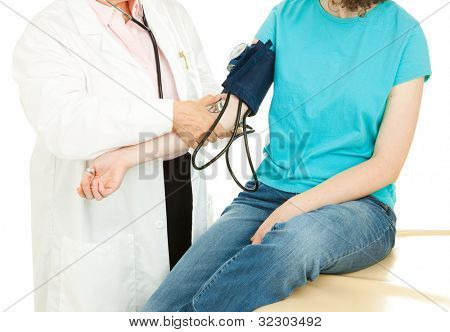 Doctor taking a young patient's blood pressure.  Closeup view.