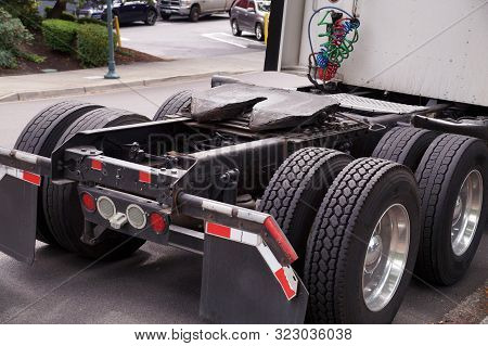 View Of The Back Part Of The 18 Wheeled Truck. Visible Fifth Wheel Couplings Are Fitted To A Tractor