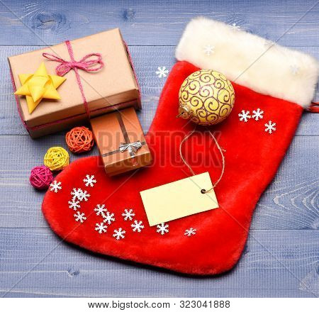 Keep Family Traditions. Stocking Stuffers Idea. Stocking With Christmas Gift Box. Christmas Sock Ton