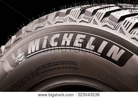 Krasnoyarsk, Russia, 15 September 2019: Michelin Logo On The Tire Close-up, Black Background. A Sign
