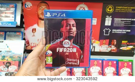 Bratislava, Slovakia, September 18 2019: Man Holding Fifa 20 Videogame On Sony Playstation 4 Console
