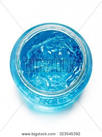 Blue gel container isolated on white background from top view. Transparent gel with bubbles close-up