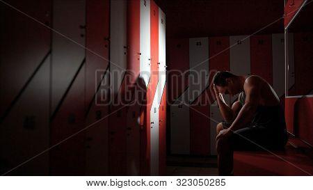 The Guy Is Worried Sitting In The Locker Room. The Athlete Is Sad In The Locker Room. Motivation And
