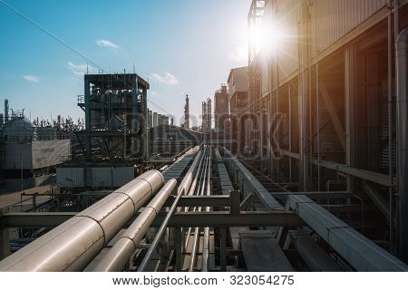 Pipeline And Pipe Rack Of Petrochemical Industrial Plant With Blue Sky Sunlight Background, Manufact