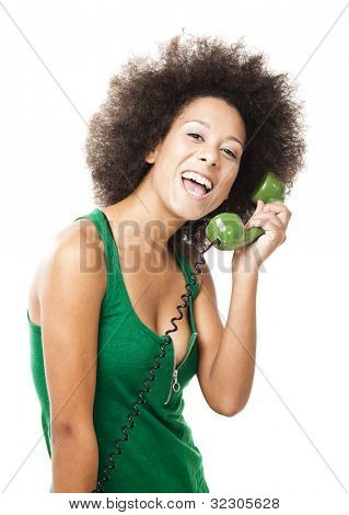 Afro-American young woman answering a call, isolated on white background