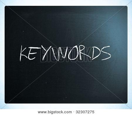 "The Word ""keywords"" Handwritten With White Chalk On A Blackboard"