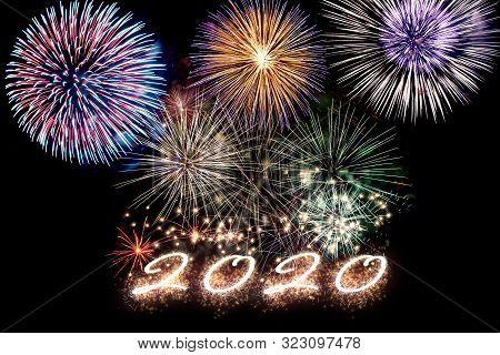 Aparkling Number 2020 With Fireworks On Dark Background. Hew Year.