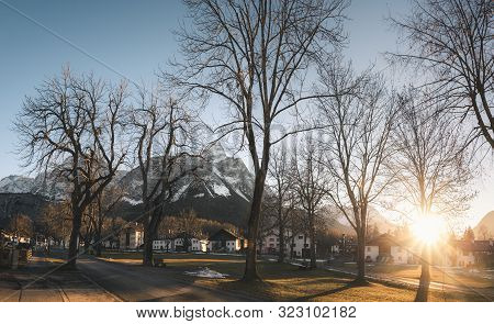 Cold Winter Sunset Over Austrian Village And The Snowy Alps Peaks, In Ehrwald, Austria, On A Sunny D