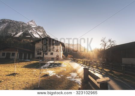 Winter Sunset Over Alpine Village And The Snow-covered Alps Mountains Peaks, In Ehrwald, Austria, On