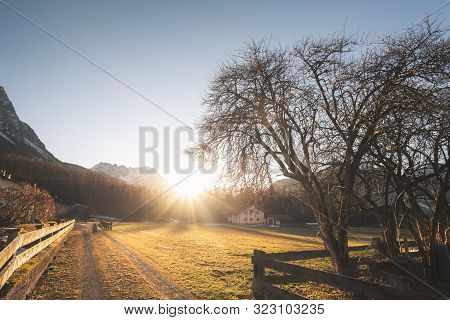 Winter Sun Rays Over Austrian Village In The Alps Mountains, On A Sunny Day Of December, Ehrwald, Au