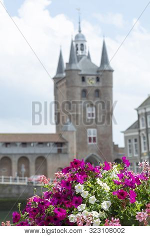 View On Old Dutch Houses And Tower In Zierikzee, Historical Town In Zeeland, Netherlands