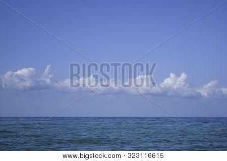 White Clouds Over The Blue Calm Sea - Nature, Beach, Landscape
