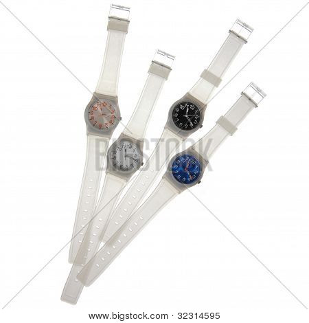 Set Of White Plastic Watches Isolated On White