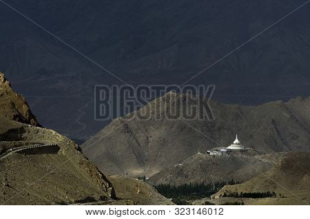 Shanti Stupa long shot, Buddhist white-domed stupa or chorten on a hilltop in Chanspa, Leh district, Ladakh, India. poster