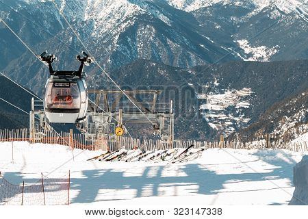 Pyrenees, Andorra - February 14, 2019: Ski Lift In The Mountains, The Silhouettes Of Tourists Inside