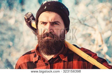 Bearded Lumberjack. Male Holds An Ax On A Shoulder. Brutal Bearded Man. Brutal Bearded Lumberjack Wi