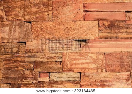 Red Laterite Stone Wall Texture Background.