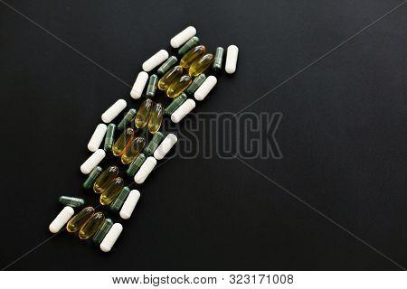 Omega 3, Spirulina, Chlorophyll,magnesium Capsules On Black Dark Background, Flat Lay. Dietary Suppl